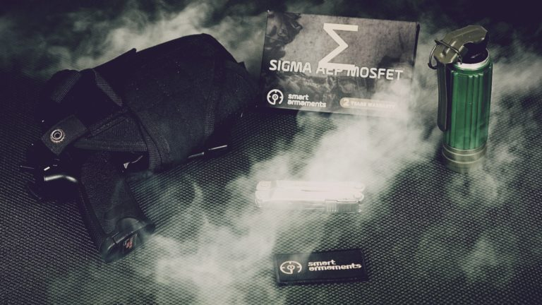 SIGMA AEP MOSFET with smoke an airsoft pistol and multitool